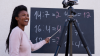 Image of Black woman teaching a class virtually